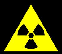Symbole officiel triangulaire français jaune et noir pour danger présence de radioactivité