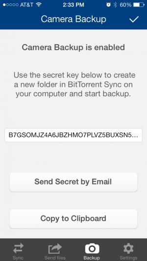 Sous iOS, envoyez-vous par email ou SMS la clef secrète du backup de votre dossier pellicule